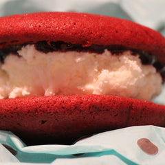 Red velvet cake with raspberry jam and coconut cream filling gourmet whoopie pies