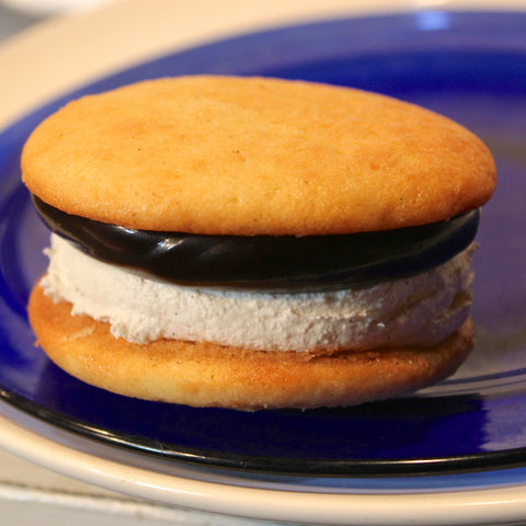 Buttery vanilla cake with fudge and vanilla cream filling whoopie pie