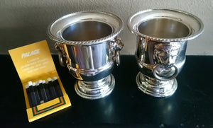 A set of 4 very small silver plated urns