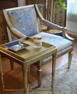 A gold leaf reproduction arm chair