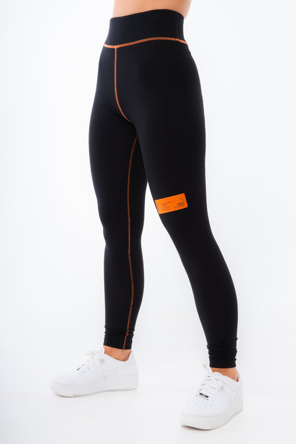 HANDLE WITH CARE OVERLOCK LEGGINGS