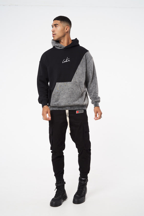SPLICED ACID WASH RELAXED FIT HOODIE