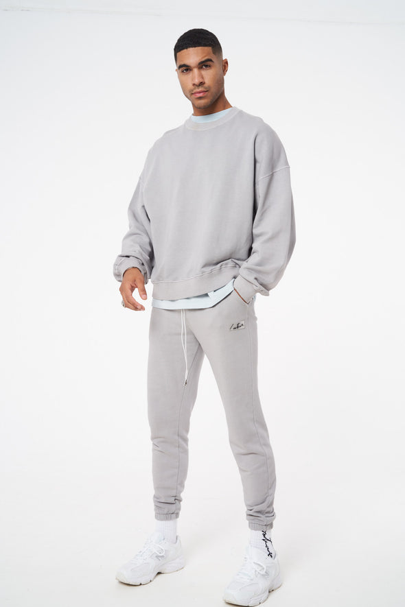 ESSENTIALS OVERSIZED OIL WASHED SWEATSHIRT