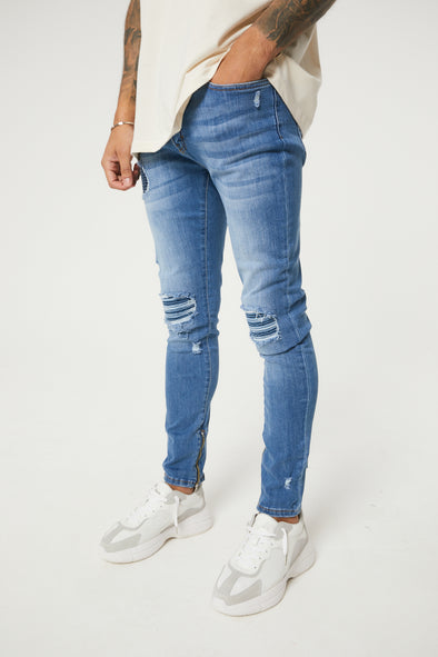 LIGHT BLUE WASH DISTRESSED BIKER SLIM FIT JEANS