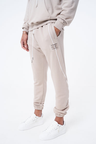 COUTURE WAVE PRINT PIPED JOGGERS