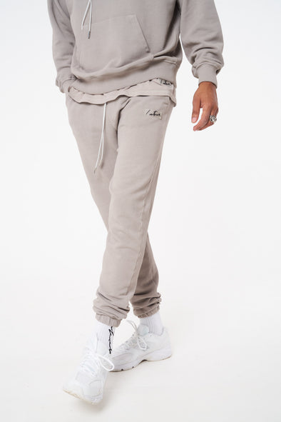 ESSENTIALS RELAXED FIT OIL WASHED JOGGER