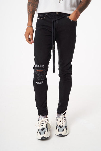 GOTHIC FONT EMBROIDERED KNEE JEANS