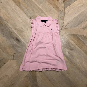 pink sleeveless cotton tennis dress with pleated hem at the back