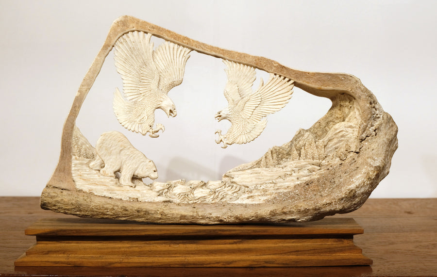 WILDLIFE SCENE CARVED FROM LARGE BONE