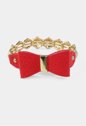 red colored bow bracelet with gold chain