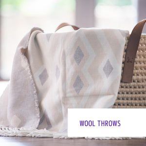 Wool throws blankets in subtle colours and beautiful designs