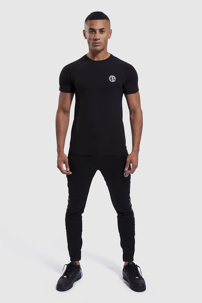 gym top and joggers in black by one athletic