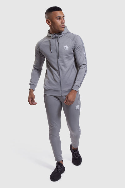 zipped up track top and gym joggers