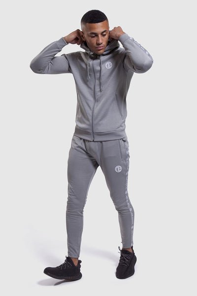 model putting up hood in Firestone II tracksuit