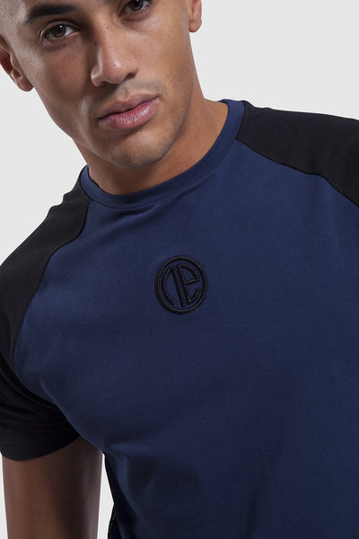 Close up on One Athletic branding on mens training top