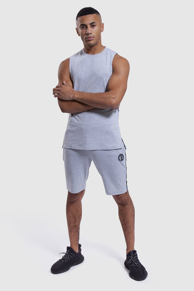 athlete wearing mens gym shorts and vest