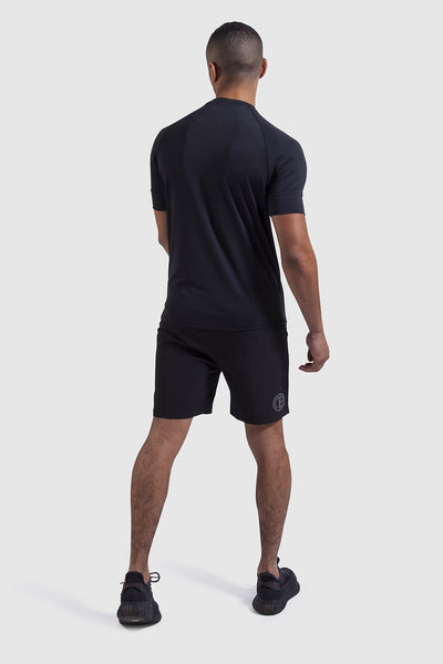 Back view on mens gym t-shirt & shorts
