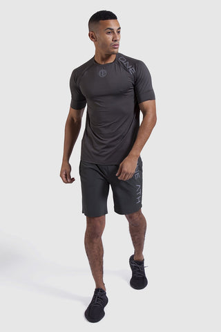 Model wearing khaki training top & shorts