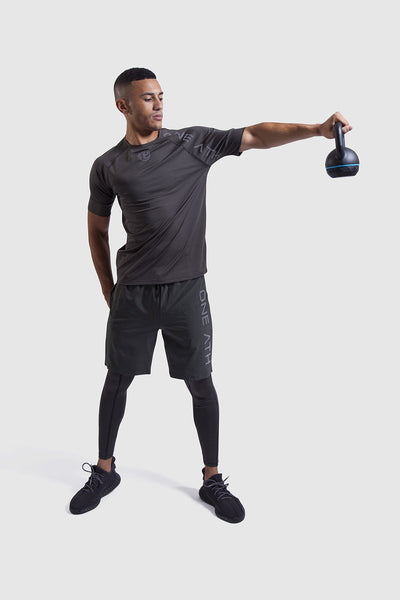 Man lifting weights in One Athletic Gymwear
