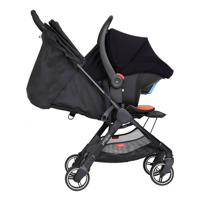 alpha™ infant car seat shown as a travel system using optional travel adaptors on a phil&teds® sport™ buggy