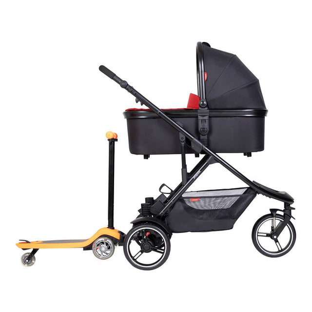 phil&teds dot inline buggy with parenting facing snug carrycot and freerider stroller board in rear