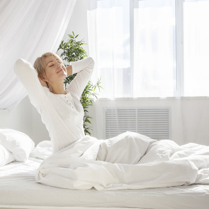 Healthy and relaxed woman on mattress