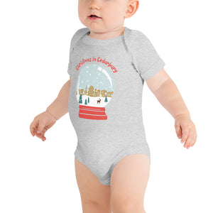 Mock up of athletic heather short sleeve baby onesie with color snow globe design