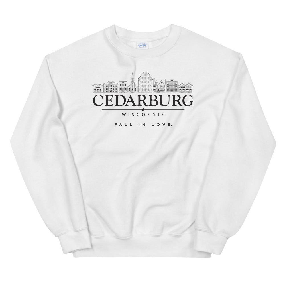 White sweatshirt with black design of historic Cedarburg with Fall in Love printed below graphic