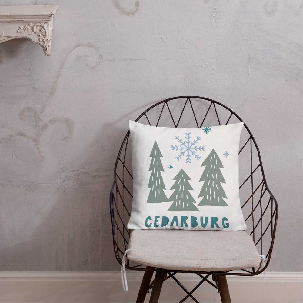 white premium pillow with Cedarburg snowy trees design in 3 colors