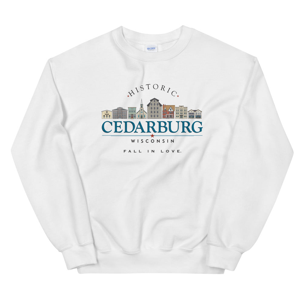 White sweatshirt with downtown image and type that says Cedarburg, Wisconsin.  fall in love with color graphic
