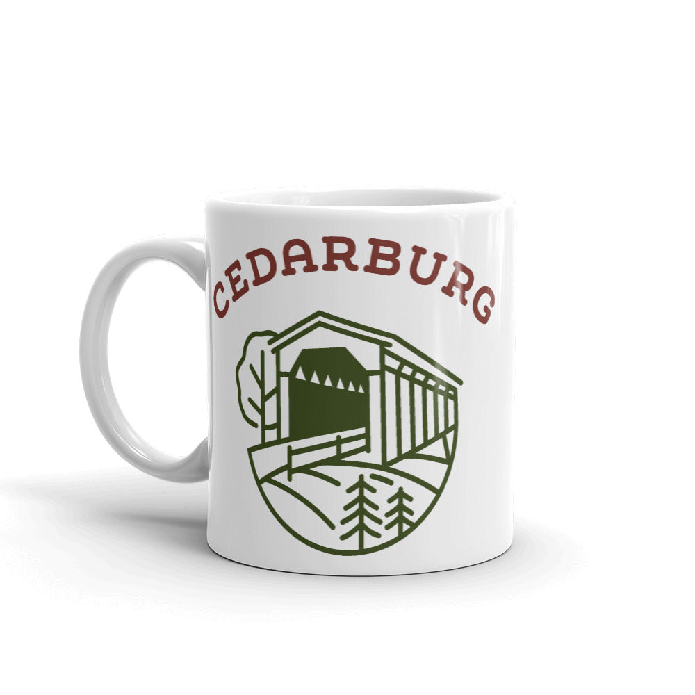 White ceramic mug with Covered bridge design in olive and red colors