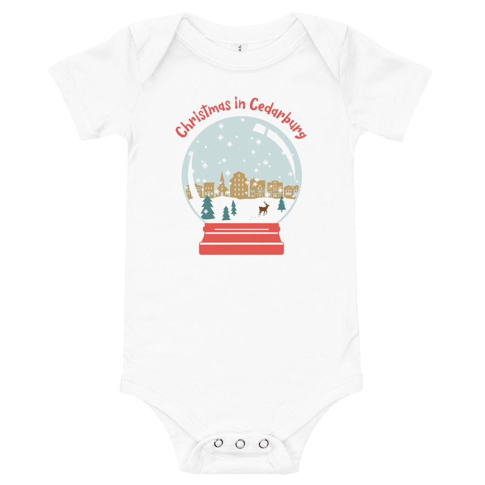 White short sleeve baby onesie with color snow globe design