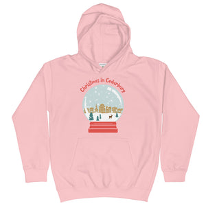 Baby Pink Kids Hoodie with snow globe Cedarburg design in color
