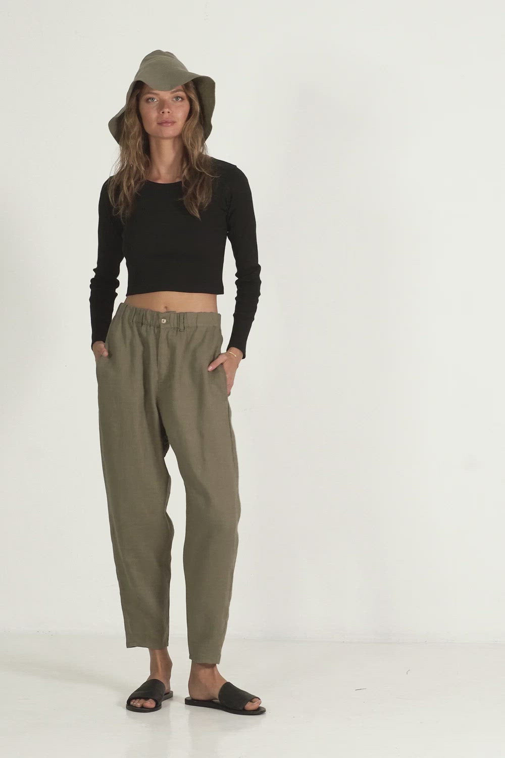 A woman wearing classic linen pants for winter by Lilya