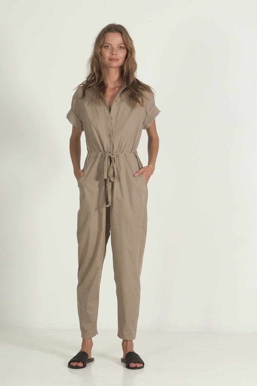 A woman in a cotton jumpsuit for autumn by Lilya