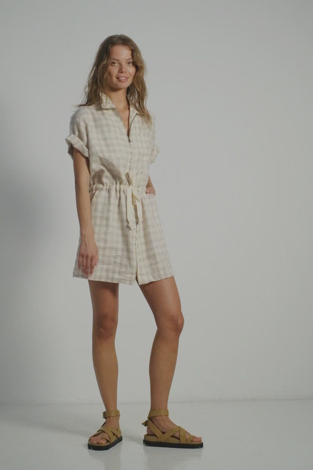 A woman in a check linen dress for summer by Lilya