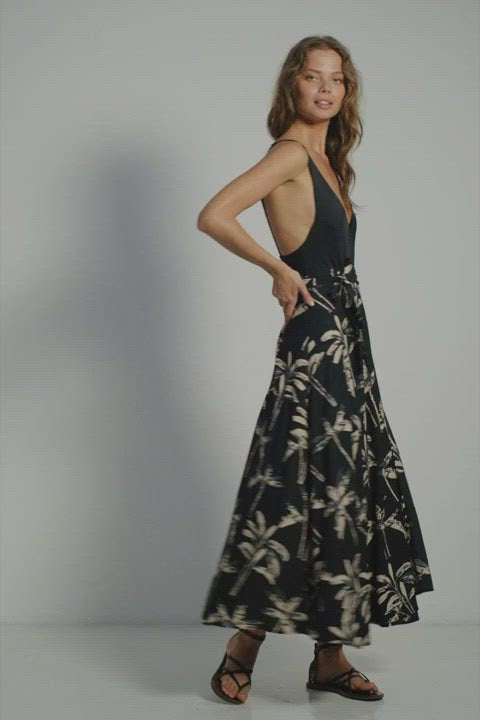 A woman in resort summer wrap around skirt by Lilya