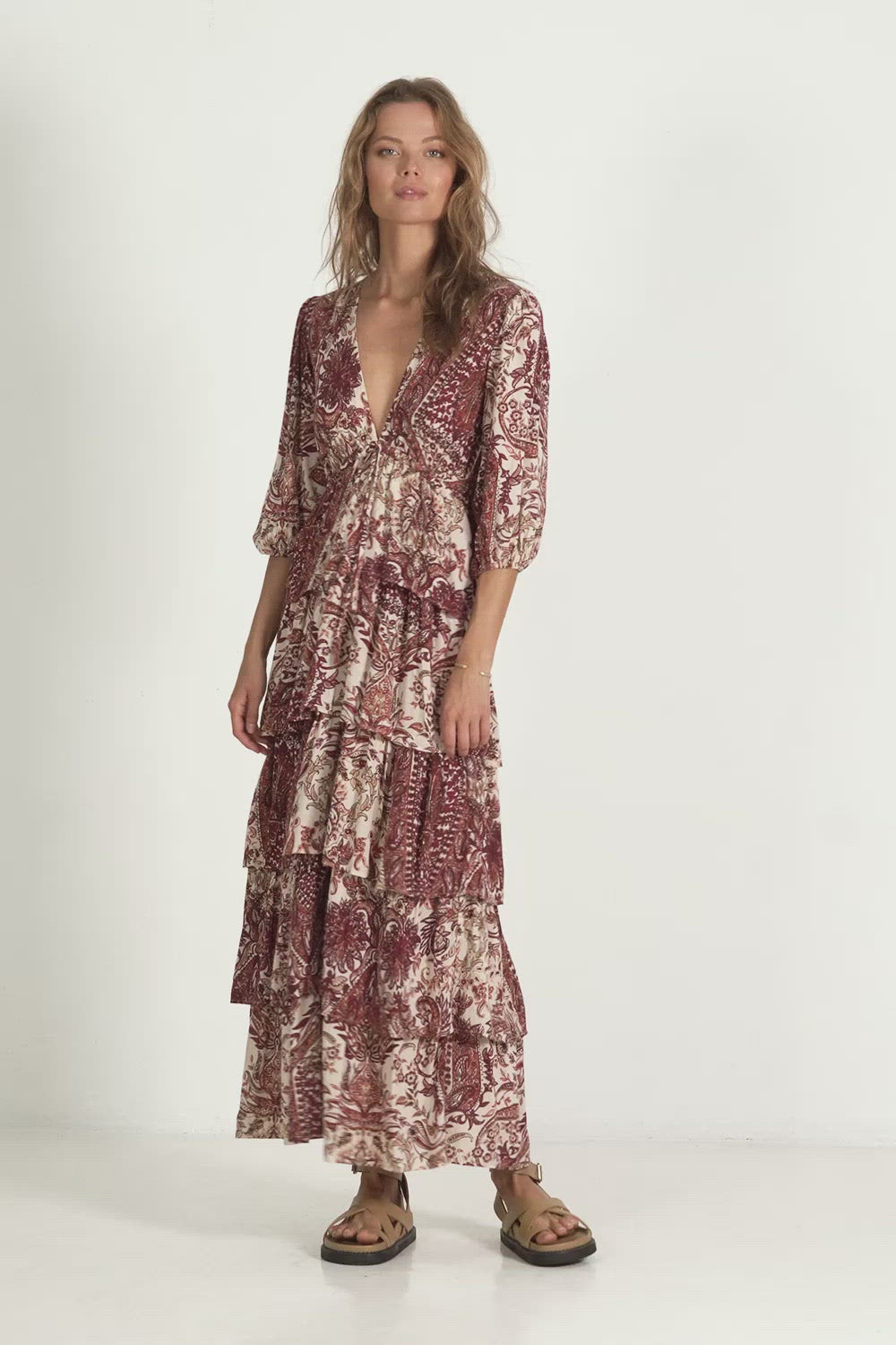 A woman wearing a Sahara maxi paisley winter dress by Lilya