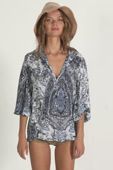 A woman in a casual winter paisley top by Lilya