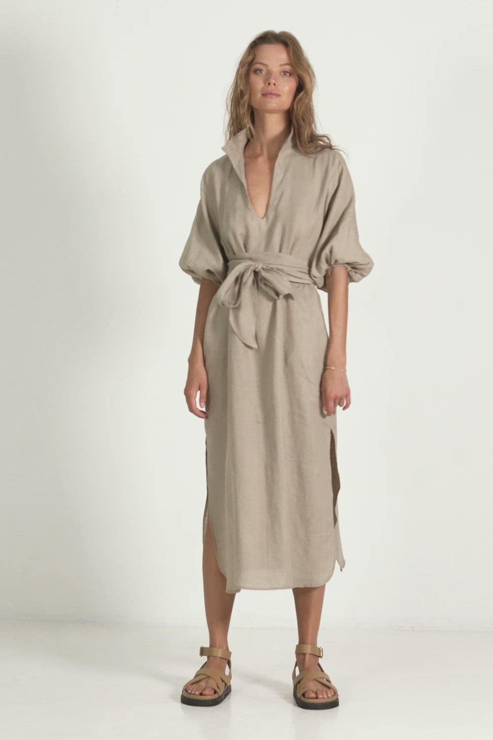 A woman in a linen maxi dress by Lilya for winter