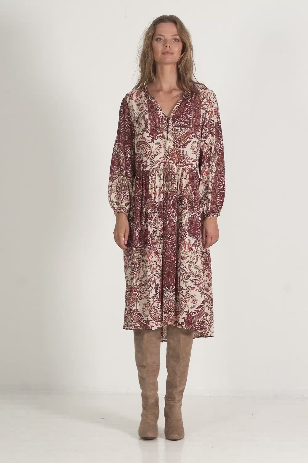 A woman in a casual paisley midi dress for winter by Lilya
