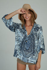 A woman in a blue paisley Agatha top by Lilya in Australia