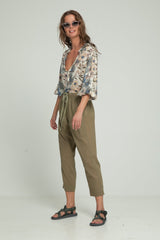 A woman wearing summer blouse and khaki pants by Lilya
