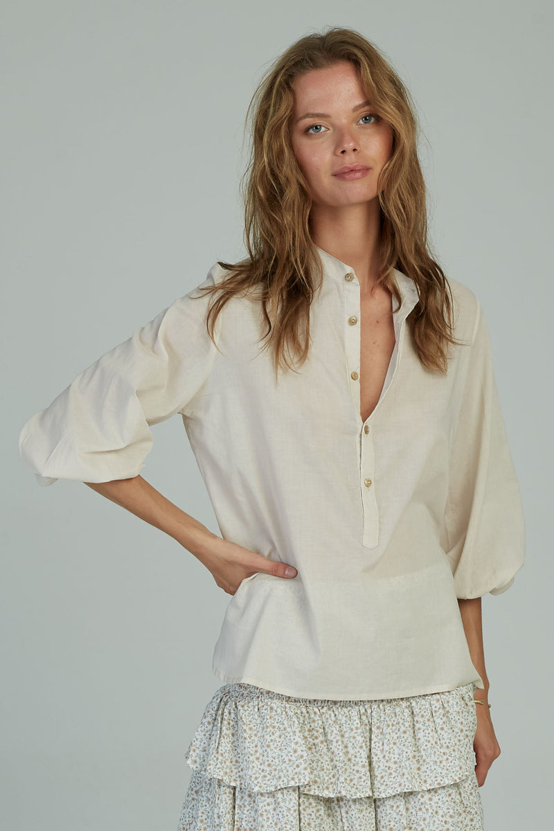 A woman in a summer cotton classic blouse by Lilya