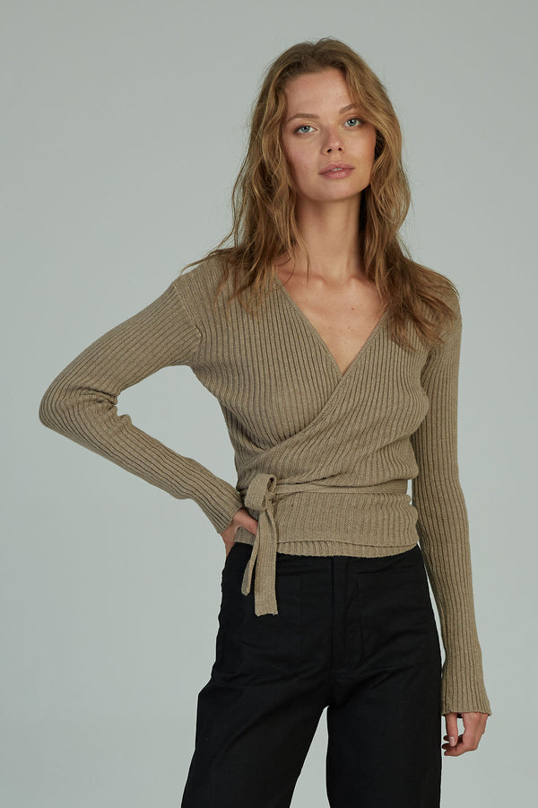 A woman in a cotton long sleeve wrap top by Lilya in Australia