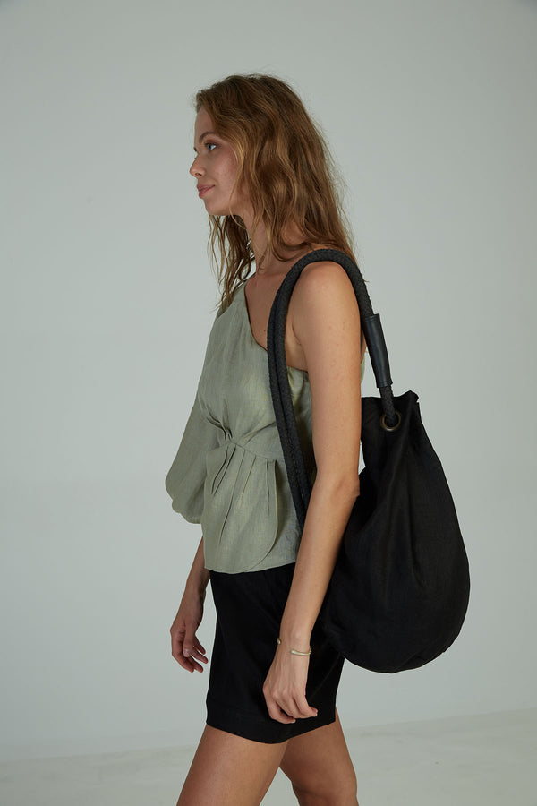 A woman wearing a casual linen bag by Lilya
