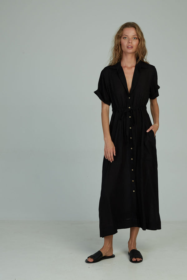 A woman in a classic maxi shirt dress by Lilya in Australia