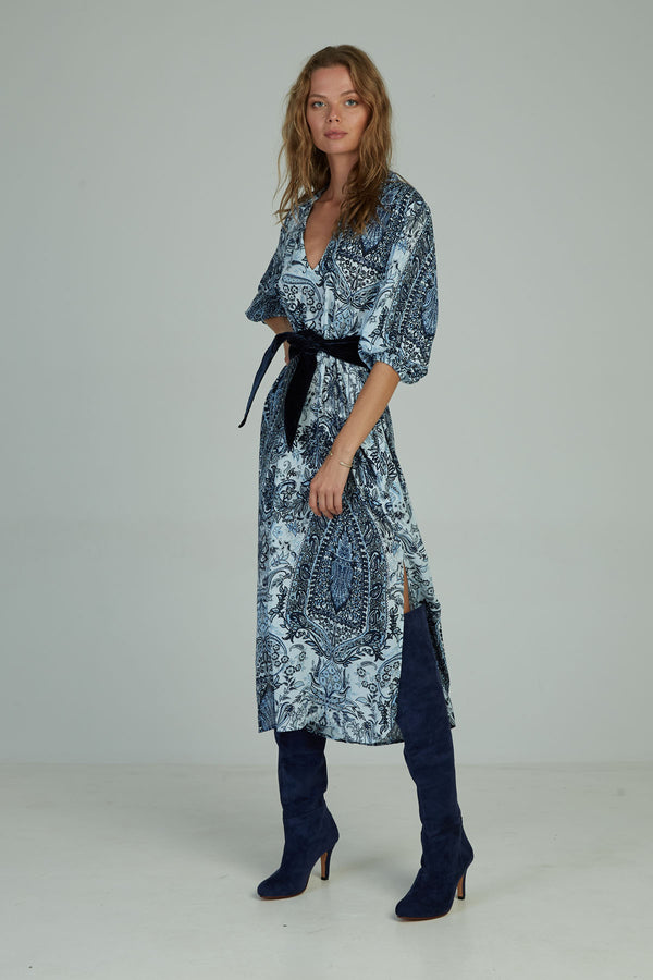 A woman in the Calma Maxi Dress Paisley Blue by Lilya in Australia