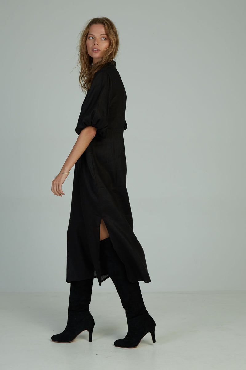 A woman in a classic winter black linen maxi dress by Lilya