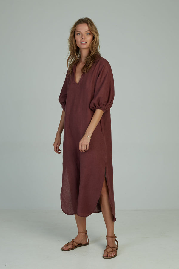 A woman in a Calma maxi dress for winter by Lilya